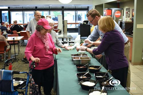 Skidmore hockey team visit The Wesley Community