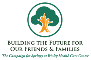 The Campaign for Springs logo. It reads Building the Future for our Friends & Family - The Campaign for Springs at Wesley Health Care Center. It features two abstract people incorporated into an oak tree as the stump.