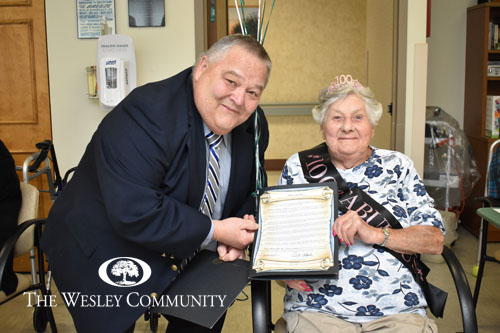 Councilman, John Frolish, presenting Helen with a Town of Milton Proclamation