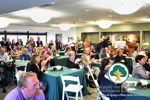 The Campaign for Springs Launch. This photo is a wide shot of the room with many people seated while listening to the launch presentation.