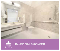 An example of the modern showers and bathrooms that will be available in resident rooms after the renovation of the Springs Building.