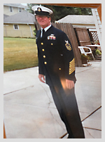 A photo of a gentleman in a US Coast Guard dress-uniform. The man is Steve, a resident of Wesley Health Care Center's Springs Building.
