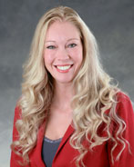 A photo of Jana Matney, WHCC Director of Nursing - A blonde woman in a red blazer smiling for the camera.