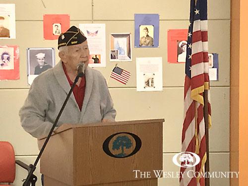 Resident veteran speaking at podium