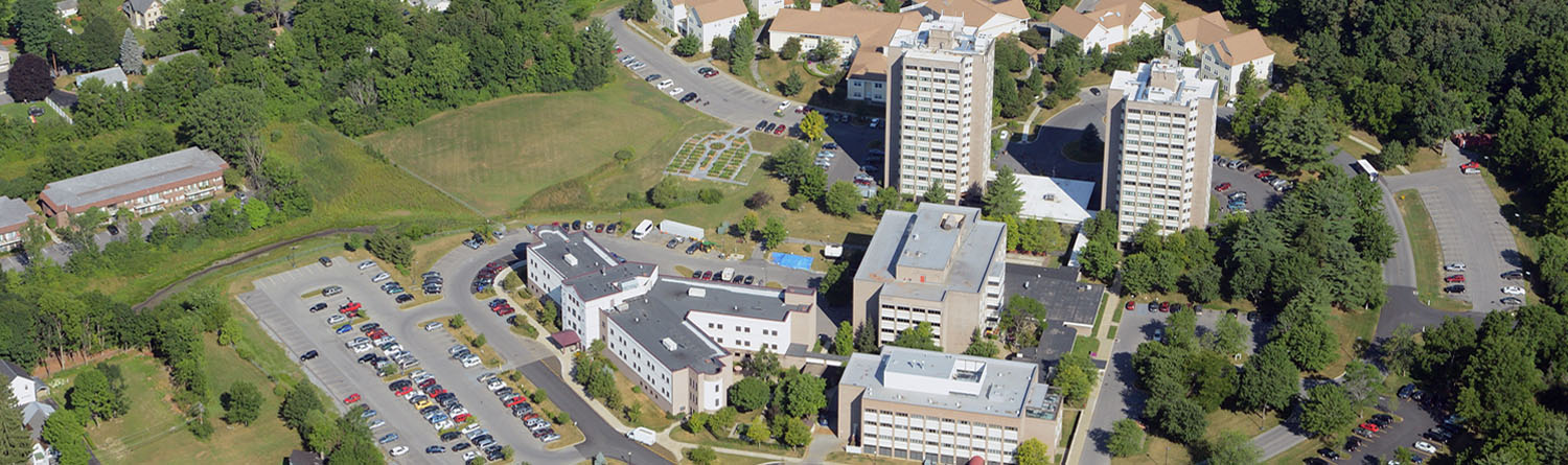 THe Wesley Community as seen from the air. A series of buildings, including two 14 story towers, surrounded by an abundance of green areas.