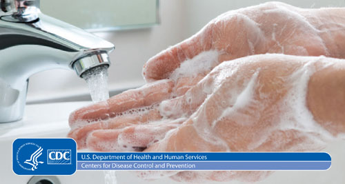 A close-up image of hands being washed in a sink with the CDC logo over it.