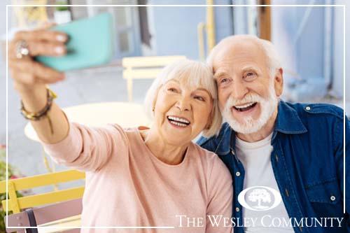 Positive senior couple taking selfie