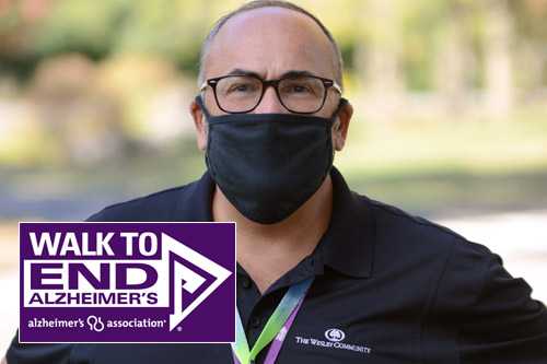 A man in health care mask and the Alzheimer's walk logo.