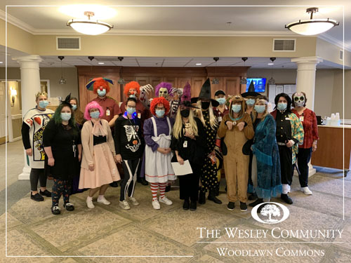 A group of workers in Halloween costumes