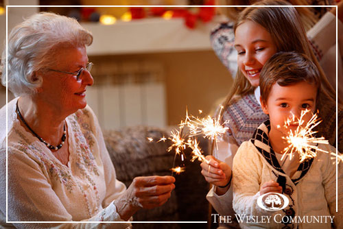 Senior woman, grandchildren and sparklers