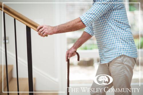 A senior man preparing to climb indoor stairs.
