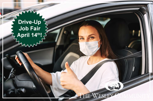 Woman with medical mask is driving a car