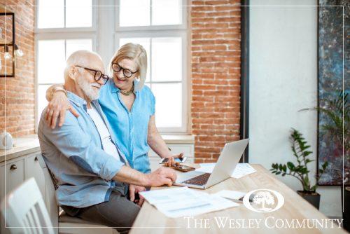 A senior couple going over finances.