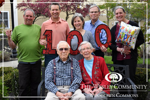 A family celebrating the 100th birthday of their patriarch.