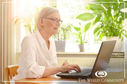 senior woman at a computer