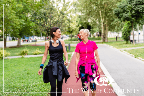 Two women walking and talking.