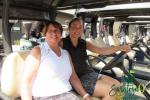 women smiling on golf cart