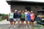 group of smiling women with golf cart
