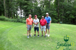 group of golfers on putting green